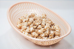 sweet popcorn in a wicker basket on a light background, Royalty Free Stock Photo