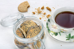 Sweet poppy seed shortbread biscuits with jam in a jar Stock Image