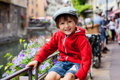 Sweet portrait of preschool boy in the town of Annecy, France, s Royalty Free Stock Photography