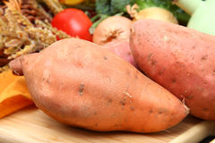Sweet potato. Es on table with other ingredients Royalty Free Stock Photo