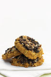 Sweet potato, almond and black chocolate cookies. Three sweet potato, almond and black chocolate cookies staked Royalty Free Stock Photography