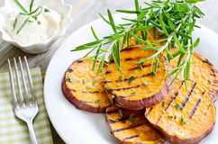 Sweet potato baked and grilled with rosemary ans sauce stock images