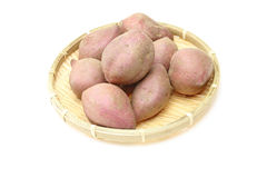 Sweet potato on a bamboo colander Stock Image