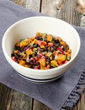 Sweet Potato Black Bean Salsa. In a bowl on a rustic table Stock Images