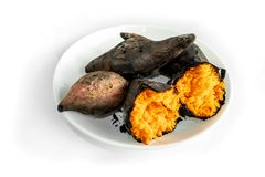 Sweet potato burned in a plate On a white background. Asian food stock photography