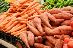 Sweet potato and carrot on market stand. Close up of sweet potato and carrot on market stand stock image