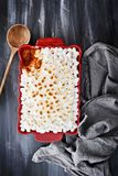 Sweet Potato Casserole Baked with Mini Marshmallows. Ready for Thanksgiving Day. A piece missing from corner. Shot from above Royalty Free Stock Photography