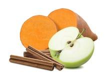 Sweet potato, cinnamon and green apple isolated on white backgro Stock Photos