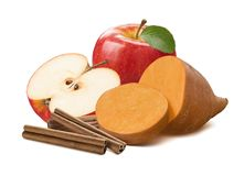Sweet potato, cinnamon and red apple half isolated on white Stock Image