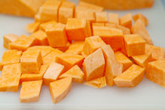 Sweet potato cubes. A pile of sweet potato cubes cleaned and cut for cooking Stock Image