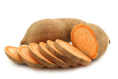 Sweet potato and a cut one Royalty Free Stock Photo
