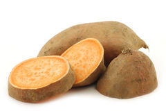 Sweet potato and a cut one Stock Image