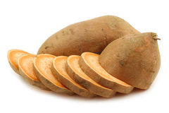 Sweet potato and a cut one Royalty Free Stock Photography