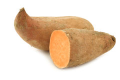 Sweet potato and a cut one Stock Photography