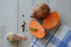 Sweet potato cut. Sweet potato on the towel ready for cooking Royalty Free Stock Images