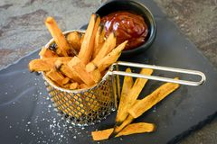Sweet Potato Fries in Metal Basket with Ketchup Royalty Free Stock Photos