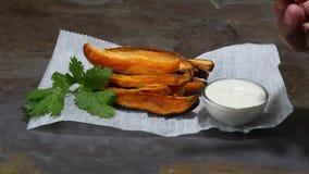 Sweet potato fries stock video footage