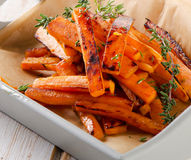 Sweet potato fries with fresh herbs Stock Images
