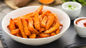Sweet potato fries. Hearty sweet potato fries served in a bowl Royalty Free Stock Image