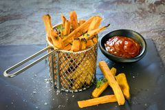 Sweet Potato Fries in Metal Basket with Ketchup Stock Photos