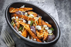 Sweet Potato Fries with Red Onion Feta Cheese and Lemon Stock Image
