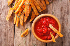 Sweet potato fries with rosemary, and ketchup close-up. horizont Stock Photos