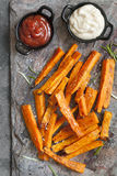 Sweet Potato Fries Top View on Slate with Ketchup and Mayonnaise Stock Photos