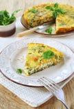 Sweet potato fritatta. Italian cuisine: green peas and sweet potato fritatta royalty free stock photos