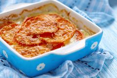 Sweet potato gratin. With cream in baking dish royalty free stock images