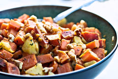 Sweet Potato Hash. A perfect dish for the holidays. Diced sweet potatoes fried with apples and seasoned with parsely and walnuts royalty free stock image