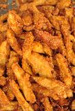 Sweet potato mixed in flour and some sesame fried. One of traditional food in Thailand market stock photography