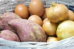 Sweet potato, onion and egg in the white basket: s Royalty Free Stock Image