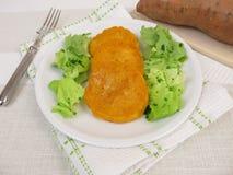 Sweet potato pancakes and salad Stock Photos