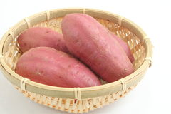 Sweet potato, 4 pieces. Sweet potatoes of basket, it is tasty Stock Images