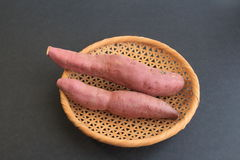 Sweet potato, 2 pieces. Two sweet potatoes. Black background Royalty Free Stock Image