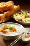 Sweet Potato Porridge. Oriental sweet potato porridge with peanut and nice table setting stock photo