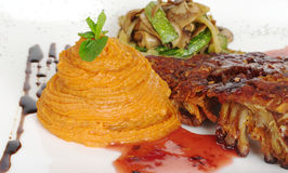 Sweet Potato Purees with Rib and Red Sauce Stock Photography