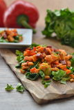 Sweet potato salad with chorizo sausage. On wooden board Stock Photos