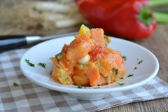 Sweet potato salad. On white plate with bell bepper in background Royalty Free Stock Photos
