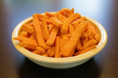 Sweet Potato Spears Bowl on Wood Table Royalty Free Stock Photo