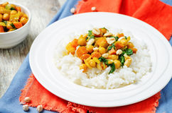 Sweet potato spinach chickpea curry with rice Stock Photo