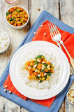 Sweet potato spinach chickpea curry with rice Stock Photos