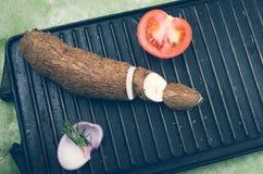 Sweet potato, tomato, onion and rosemary on grill Stock Photos
