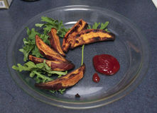 Sweet Potato Wedges. A plate of freshly made oven baked sweet potato wedges. Homemade Stock Photos