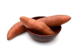 Sweet potato on the white background. Sweet potatoes in bowl on white background used in cooking Royalty Free Stock Image