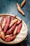 Sweet potato in a wicker basket stock photos