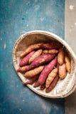 Sweet potato in a wicker sieve stock image