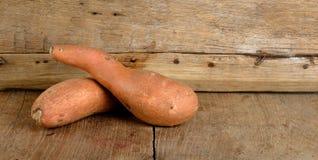 Sweet potato on the wooden background Stock Photos