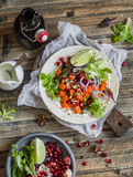 Sweet potato wrap sandwich and beer. Delicious vegetarian snack. On a wooden rustic table. Top view Stock Photography