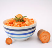 Sweet potatoes. Some fresh, raw sweet potatoes in a bowl Royalty Free Stock Photography